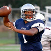 Enid quarterback, Fred Lawrence, throws a pass against during a scrimmage against Putnam City August 22. (Staff Photo by BILLY HEFTON)