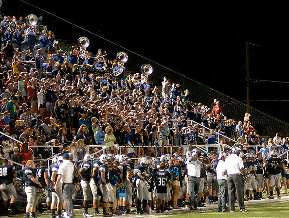 Enid Plainsmen fans cheer during a game against Ponca City at D. Bruce Selby Stadium Friday, Sept. 5, 2014. (Staff Photo by BONNIE VCULEK)