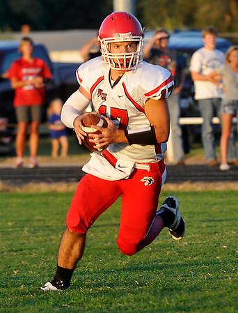 Kremlin-Hillsdale's Andre Lizar looks for a receiver against Deer Creek-Lamont September 4, 2014 at Deer Creek-Lamont High School. (Staff Photo by BILLY HEFTON)