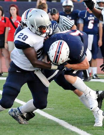 Enid's Devin Pratt brings down Ponca City quarterback, Connor Larson, Friday September 5, 2015 at Ponca City High School. (Billy Hefton | Enid News & Eagle)
