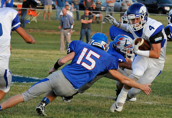 Covington-Douglas' Connor Nunley cuts away from Waukomis' Chris Henderson Thursday September 1, 2016 at Waukomis HIgh School. (Billy Hefton / Enid News & Eagle)