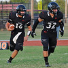 OBA's JWill LaForce follows Tanner Athey around end against Alva Friday September 9, 2016 at Oklahoma Bible Academy. (Billy Hefton / Enid News & Eagle)