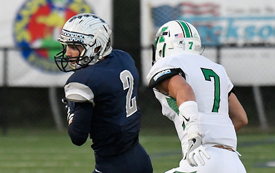 Enid's Colton Troxell catches a pass in front of Bautista Baiocchi of Bishop McGuinness Friday September 16, 2016 at D. Bruce Selby Stadium. (Billy Hefton / Enid News & Eagle)