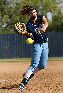 Enid's Izzy Plunkett delivers a pitch against Sapulpa Tuesday September 6, 2016 at Pacer Field. (Billy Hefton / Enid News & Eagle)