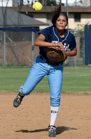 Enid'sMarybel Garcia makes a throw to first against Sapulpa Tuesday September 6, 2016 at Pacer Field. (Billy Hefton / Enid News & Eagle)