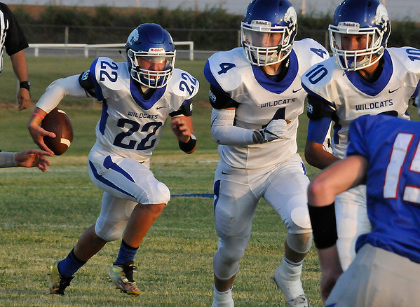 Covington-Douglas' Gavin Smith (22) follows blockers Connor Nunley (4) and Brandon Row (10) against Waukomis Thursday September 1, 2016 at Waukomis HIgh School. (Billy Hefton / Enid News & Eagle)