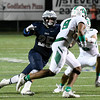 Enid's Kros Bay runs down Rubell Goe of Bishop McGuinness Friday September 16, 2016 at D. Bruce Selby Stadium. (Billy Hefton / Enid News & Eagle)