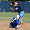 Enid's Alicia Chain looks to make a throw to first after forcing out Sapulpa's Ally Zanca Tuesday September 6, 2016 at Pacer Field. (Billy Hefton / Enid News & Eagle)