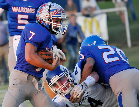 Waukomis' Phillip Busbee runs off the block of Robert Bracken against Covington-Douglas Thursday September 1, 2016 at Waukomis HIgh School. (Billy Hefton / Enid News & Eagle)