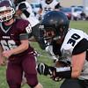 Pond Creek-Hinter'sZac davis runs after making a catch against Pioneer Friday September 8, 2017 at Pioneer High School. (Billy Hefton / Enid News & Eagle)
