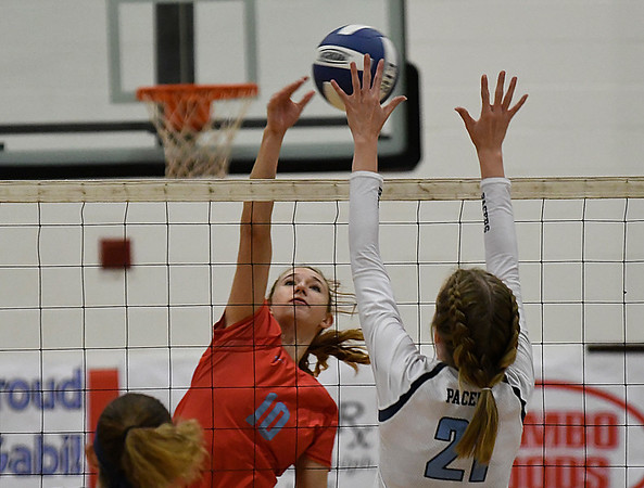 Chisholm's Raylee Savage hits the ball agianst Enid's Emily Peterson Tuesday September 5, 2017 at the NOC Mabee Center. (Billy Hefton / Enid News & Eagle)