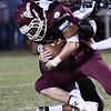 Pond Creek-Hinter's Marvin Faison sacks Pioneer's Layken Young Friday September 8, 2017 at Pioneer High School. (Billy Hefton / Enid News & Eagle)