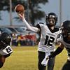 Pond Creek-Hinter's Tyler Kerr throws a pass against Pioneer Friday September 8, 2017 at Pioneer High School. (Billy Hefton / Enid News & Eagle)