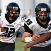 Pond Creek-Hinter's Cole Jones (22) follows the blocking of Jake Davis (55) against Pioneer Friday September 8, 2017 at Pioneer High School. (Billy Hefton / Enid News & Eagle)