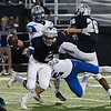 Enid's Mason Skrimager ties to get away from Choctaw's Caden Young Friday September 29, 2017 at D. Bruce Selby Stadium. (Billy Hefton / Enid News & Eagle)
