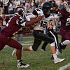 Pond Creek-Hinter's Tyler Kerr tries to run pass Pioneer defenders, Z. J. Washington and Bradon Hoy Friday September 8, 2017 at Pioneer High School. (Billy Hefton / Enid News & Eagle)