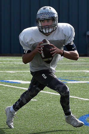 Enid's Mason Skrimager rolls out during practice Thursday September 28, 2017 at D. Bruce Selby Stadium. (Billy Hefton / Enid News & Eagle)