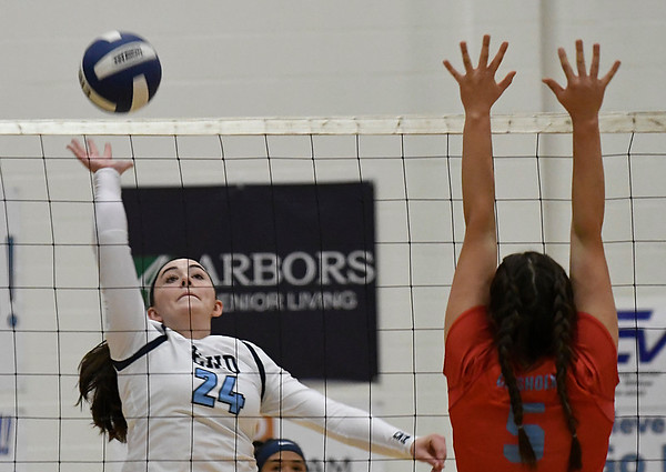 Enid's Gabi Cotarelo hits the ball against Chisholm's Braylee Stute Tuesday September 5, 2017 at the NOC Mabee Center. (Billy Hefton / Enid News & Eagle)