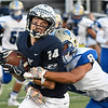 Enid's Ryan Stotts is hit by Choctaw's Deysean Young after making a catch Friday September 29, 2017 at D. Bruce Selby Stadium. (Billy Hefton / Enid News & Eagle)