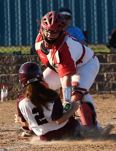 Chisholm's Maegan Jackson tags out Pioneer's Katelyn McCartney at home plate in the top of the 7th inning preserving a tie ballgame Tuesday September 18, 2018 at Chisholm High School. (Billy Hefton / Enid News & Eagle)