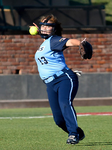 Enid's Kyana Martin makes a throw to first against Choctaw Monday September 10, 2018 at David Allen Memorial Ballpark. (Billy Hefton / Enid News & Eagle)