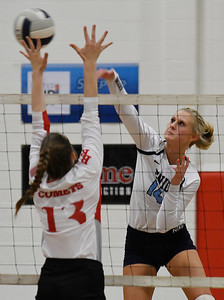Enid's Hanna Brinley hits the ball against Tulsa Kelley's Sabina Busch Tuesday September 11, 2018 at the NOC Mabee Center. (Billy Hefton / Enid news & Eagle)