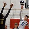 Enid's Emily Peterson knocks the ball over the net against Midwest City's Aria Waston Tuesday September 25, 2018 at the NOC Mabee Center. (Billy Hefton / Enid News & Eagle)
