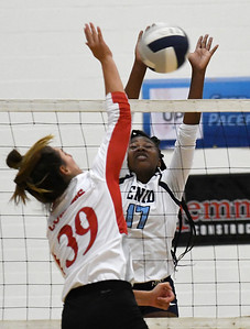 Enid's Zurae Robinson attempts to block the shot of Tulsa Kelley's Mia Moazami Tuesday September 11, 2018 at the NOC Mabee Center. (Billy Hefton / Enid news & Eagle)
