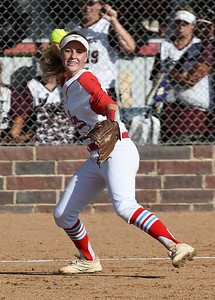 Chisholm's Regi Pasby makes a throw to first against Pioneer Tuesday September 18, 2018 at Chisholm High School. (Billy Hefton / Enid News & Eagle)
