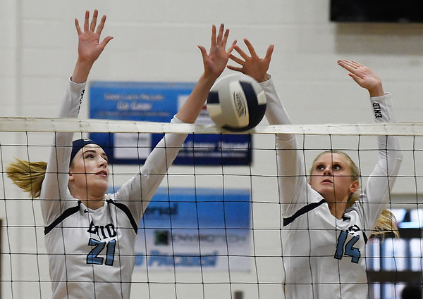 Enid's Emily Peterson and Hanna Brinley block a shot against Tulsa Kelley Tuesday September 11, 2018 at the NOC Mabee Center. (Billy Hefton / Enid news & Eagle)