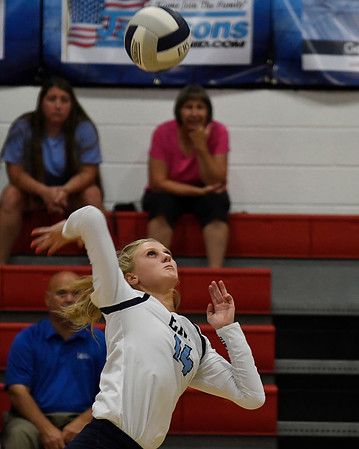 Enid's Hanna Brinley hits the ball against Tulsa Kelley Tuesday September 11, 2018 at the NOC Mabee Center. (Billy Hefton / Enid news & Eagle)
