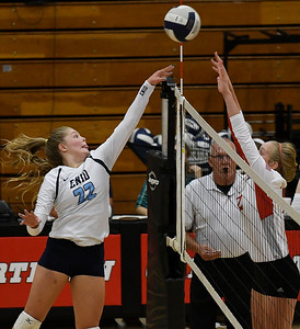Enid's Catherine Cummingham tries to knock the ball over Tulsa Kelley's Emma Frette Tuesday September 11, 2018 at the NOC Mabee Center. (Billy Hefton / Enid news & Eagle)