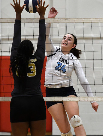Enid's Gabi Cotarelo hits the ball against Midwest City's Jazmyne Thompson Tuesday September 25, 2018 at the NOC Mabee Center. (Billy Hefton / Enid News & Eagle)