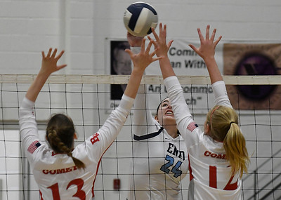 Enid's Gabi Cotarelo hits the ball against Tulsa Kelley's Emma Frette and Sabina Busch Tuesday September 11, 2018 at the NOC Mabee Center. (Billy Hefton / Enid news & Eagle)