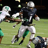 Enid's Will Phillips tries to get pass McGuinness's Brynden Walker Friday September 14, 2018 at D. Bruce Selby Stadium. (Billy Hefton / Enid News & Eagle)