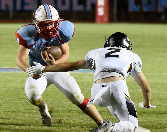 Chisholm's Lane Smith carries the ball against Alva's Kaden Hensley Friday September 28, 2018 at Chisholm High School. (Billy Hefton / Enid News & Eagle)