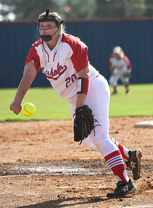 Chisholm starting pitcher, Emma Marlatt, delivers a pitch against Pioneer Tuesday September 18, 2018 at Chisholm High School. (Billy Hefton / Enid News & Eagle)