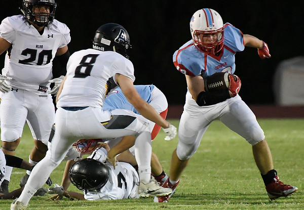 Chisholm's Bryce Boeckman carries the ball against Alva's Cameron Gordon Friday September 28, 2018 at Chisholm High School. (Billy Hefton / Enid News & Eagle)