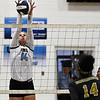Enid's Hanna Brinley blocks the shot of Midwest City's Mariah Hawkins Tuesday September 25, 2018 at the NOC Mabee Center. (Billy Hefton / Enid News & Eagle)