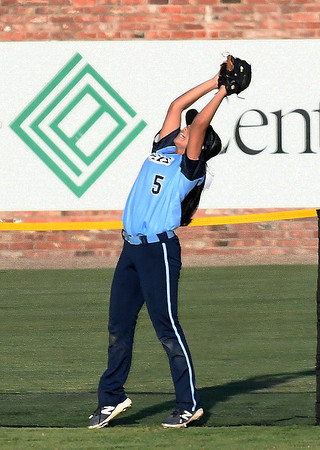 Enid's Tori Jackson robs a Choctaw player of a homerun Monday September 10, 2018 at David Allen Memorial Ballpark. (Billy Hefton / Enid News & Eagle)