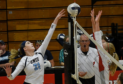 Enid's Emily Peterson tries to knock the ball over Tulsa Kelley's Emma Frette Tuesday September 11, 2018 at the NOC Mabee Center. (Billy Hefton / Enid news & Eagle)