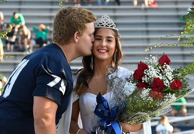 Enid High School homecoming queen, Laruen Jackson, receives the traditional kiss from homecoming king, Colton Dodd, Friday September 14, 2018 at D. Bruce Selby Stadium. (Billy Hefton / Enid News & Eagle)