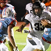 Alva's Dalton Hess runs by Chisholm's T.C. Smith Friday September 28, 2018 at Chisholm High School. (Billy Hefton / Enid News & Eagle)