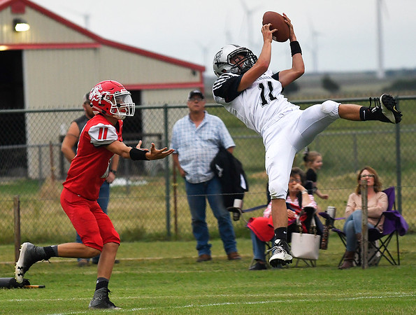 Timberlake's Alec Judd intercepts a pass in front of Kremlin-Hillsdale's Miguel Rodriguez during the first quarter Thursday September 6, 2018 at Kremlin-Hillsdale HIgh School. (Billy Hefton / Enid News & Eagle)