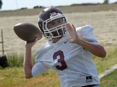 Pioneer's Ty Dennett throws a pass during practice Wednesday, September 11, 2019 at Pioneer High School. (Billy Hefton / Enid News & Eagle)