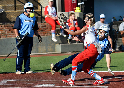 Enid's Mary Ketterman slides into home to score ahead of the tag from Chisholm's Macie Andrews Tuesday, September 17, 2019 at David Allen Memorial Ballpark. (Billy Hefton / Enid news & Eagle)