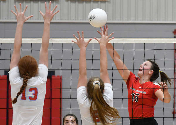 OBA's Ashlyn Orr tries to get the ball pass Chisholm's Brooklyn Willson and Lydia Peace Monday September 9, 2019 at Chisholm Middle School. (Billy Hefton / Enid News & Eagle)