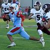 Chisholm's Garrett Eagan runs pass Perry's Jake Thomas and Carson Rames Friday, September 27, 2019 at Chisholm High School. (Billy Hefton / Enid News & Eagle)