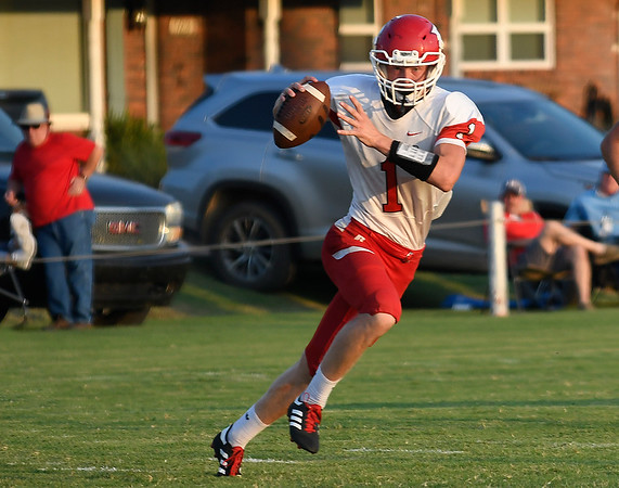 Ringwood's Reed Mason scranbles out of the pocket against Timberlake Thursday, September 5, 2019 at Timberlake High School. (Billy Hefton / Enid News & Eagle)
