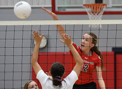 OBA's Reese Westrope hits the ball over Chisholm's Raylee Savage Monday September 9, 2019 at Chisholm Middle School. (Billy Hefton / Enid News & Eagle)